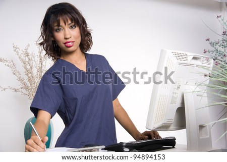 Pretty Health Worker Female Hospital Employee Working Patient Charts - stock photo
