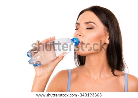 Pretty healthy girl drinking water