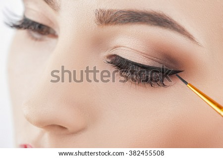 Pretty healthy girl in doing wonderful make-up - stock photo
