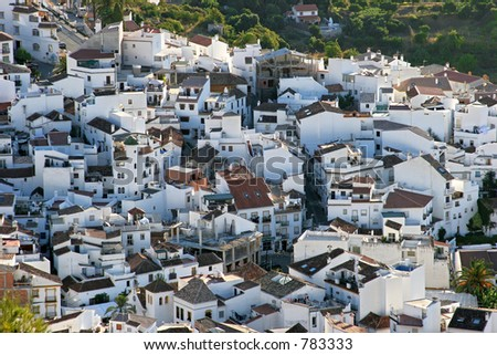 Pretty hillside town of Ojen near Marbella in Spain  showing compact and pueblo style housing