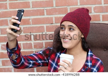 Pretty hipster ethic girl taking selfie - stock photo