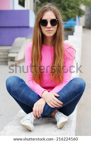 Pretty hipster girl in sunglasses. Lifestyle outdoor portrait.  - stock photo