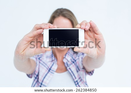 Pretty hipster taking selfie with smartphone on white background