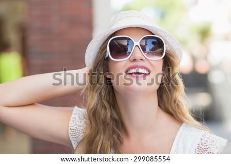 Pretty hipster woman enjoying the sun wearing sunglasses - stock photo