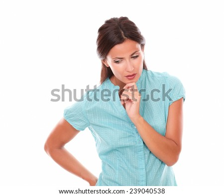Pretty hispanic holding chin and wondering while looking down in white background - copyspace - stock photo