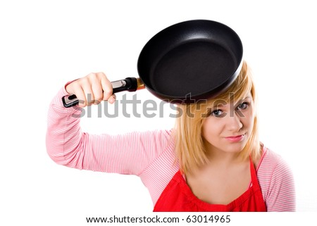 pretty housewife with pan on her head isolated on white background - stock photo