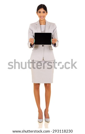 pretty indian businesswoman presenting tablet computer over white background - stock photo