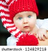 pretty infant in red hat - stock photo