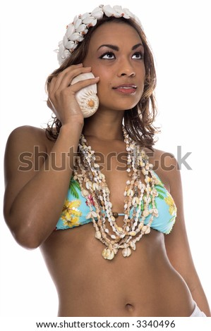 Pretty Island girl in a bikini top, shell necklaces and a crown of shells listening to a Sea Shell