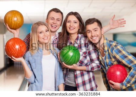 Pretty kegling team is ready to play - stock photo