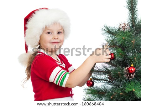 pretty kid girl decorating Christmas tree isolated on white - stock photo