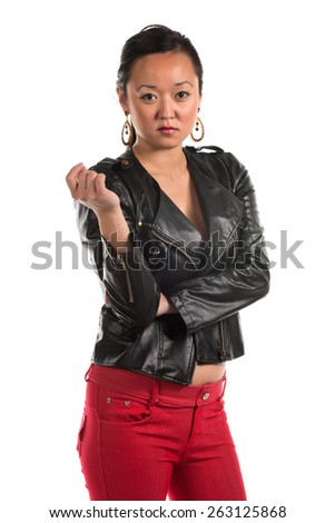 Pretty Korean woman in a black leather jacket and red jeans - stock photo