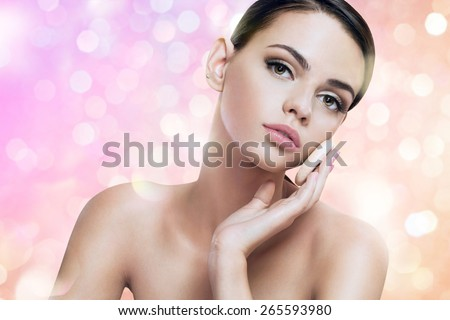 Pretty lady enjoy a flawless skin, skin care concept / photoset of attractive brunette girl on blurred pink background with bokeh  - stock photo