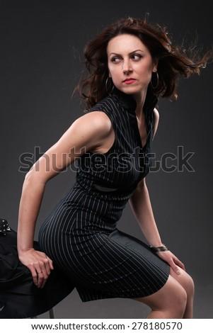 Pretty lady in a elegant black dress. - stock photo