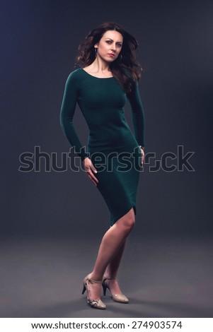 Pretty lady in a elegant green dress, toned photo. - stock photo