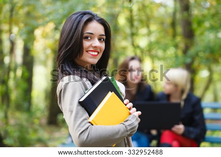 Pretty lady in the college campus prepared to pass all her exams. - stock photo