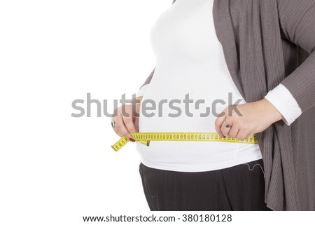 Pretty large, fat girl with a measuring tape isolated on white - stock photo