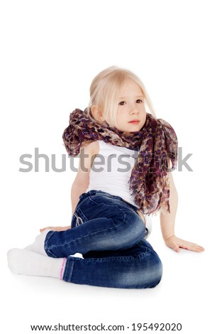 pretty little blond girl in the jeans and fashion scarf