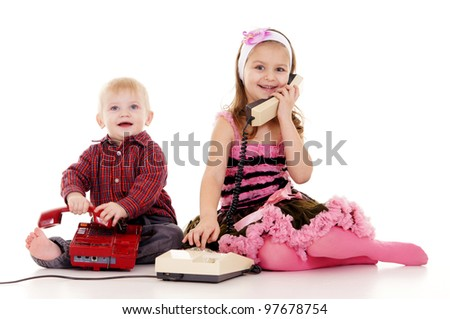 pretty little boy and girl with telephones