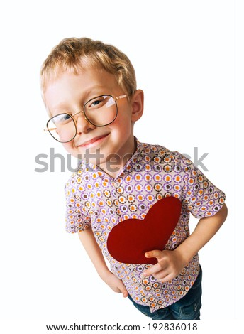 Pretty little boy with paper heart - stock photo