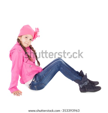 pretty little child in the jeans, pink jacket and cap