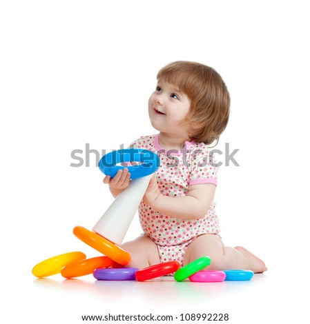 pretty little child or kid playing with color toy - stock photo