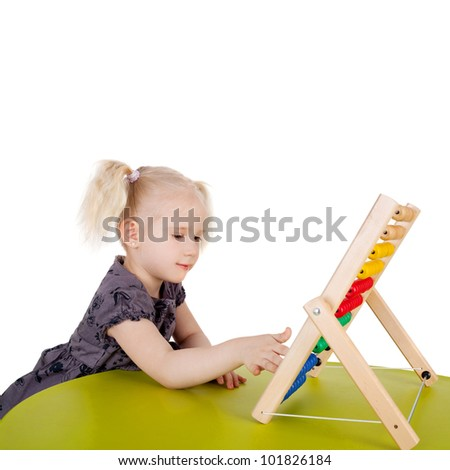 pretty little child playing with the abacus - stock photo