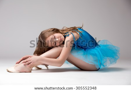 Pretty little dancer posing with eyes closed - stock photo