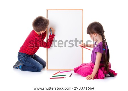 Pretty little girl and boy drawing on blank board - stock photo
