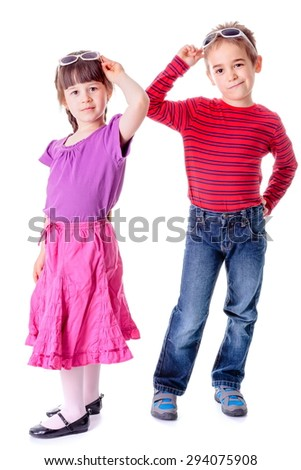 Pretty little girl and boy with sunglasses in studio - stock photo