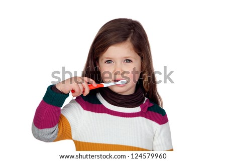 Pretty little girl brushing teeth isolated on white background - stock photo