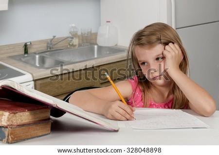 Pretty little girl doing her school homework - stock photo