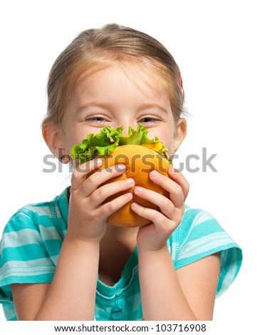 Pretty little girl eating a sandwich isolated on white background - stock photo