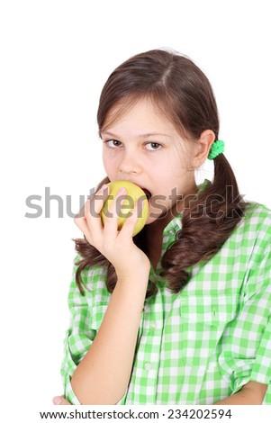 pretty little girl eating apple - stock photo