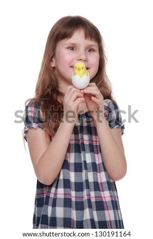 Pretty little girl holding a chicken egg for Easter - stock photo