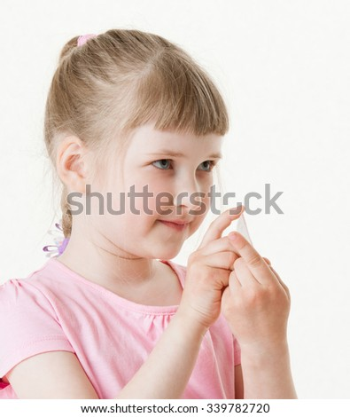Pretty little girl holding the small card , white background