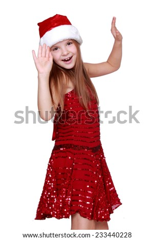 Pretty little girl in a beautiful dress/Elegant young girl  dancing on Christmas - stock photo