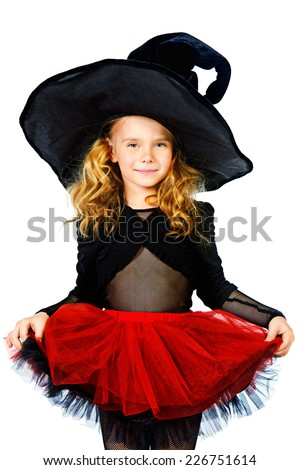 Pretty little girl in a witch costume. Halloween. Isolated over white. - stock photo