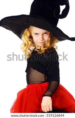 Pretty little girl in a witch costume. Halloween. Isolated over white.