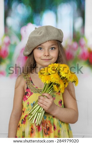 Pretty little girl in beret with dandelions in her hand - children beauty and fashion concept - stock photo