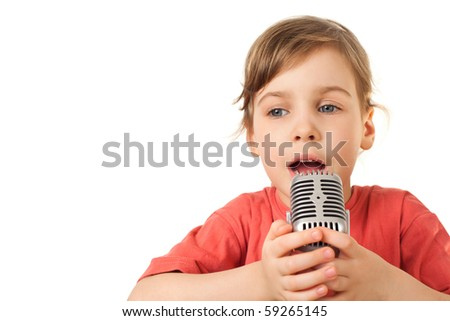 pretty little girl in red T-shirt sing in microphone isolated on white background - stock photo