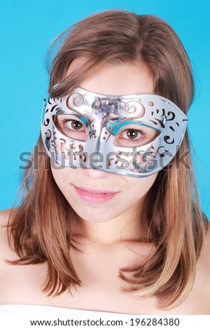 pretty little girl in the carnival mask