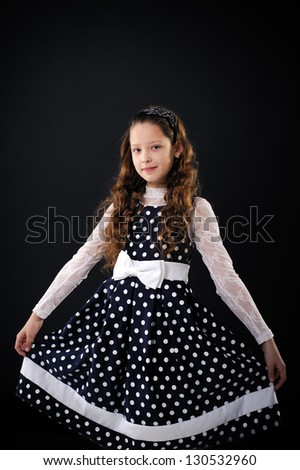 Pretty little girl isolated on black background
