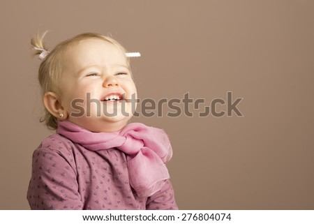 Pretty little girl laughing, copy space for text - stock photo