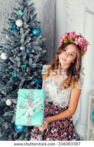 pretty little girl near the new year tree. beautiful girl in dress near Christmas tree waiting for holiday. little Princess