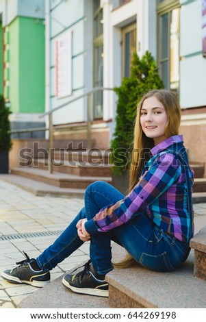 Pretty Little Girl outdoors in city on beautiful spring day