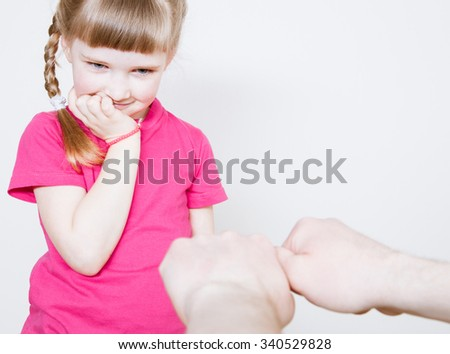 Pretty little girl playing with her father, white background