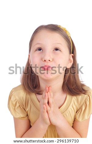 pretty little girl praying for something - stock photo