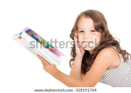 pretty little girl reading a book