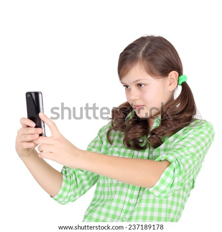 pretty little girl shooting by her mobile phone